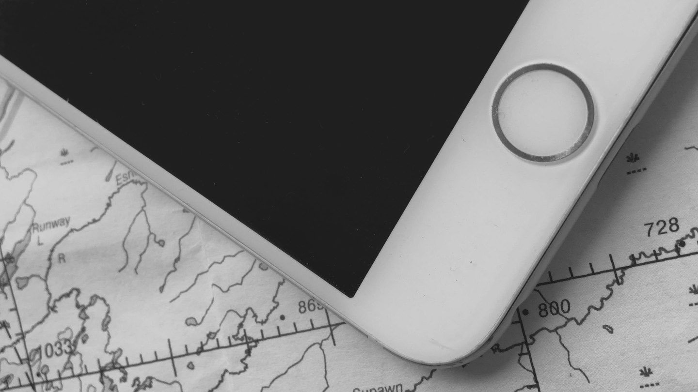 Image of iphone on top of map | Image © ExpatAlli.com