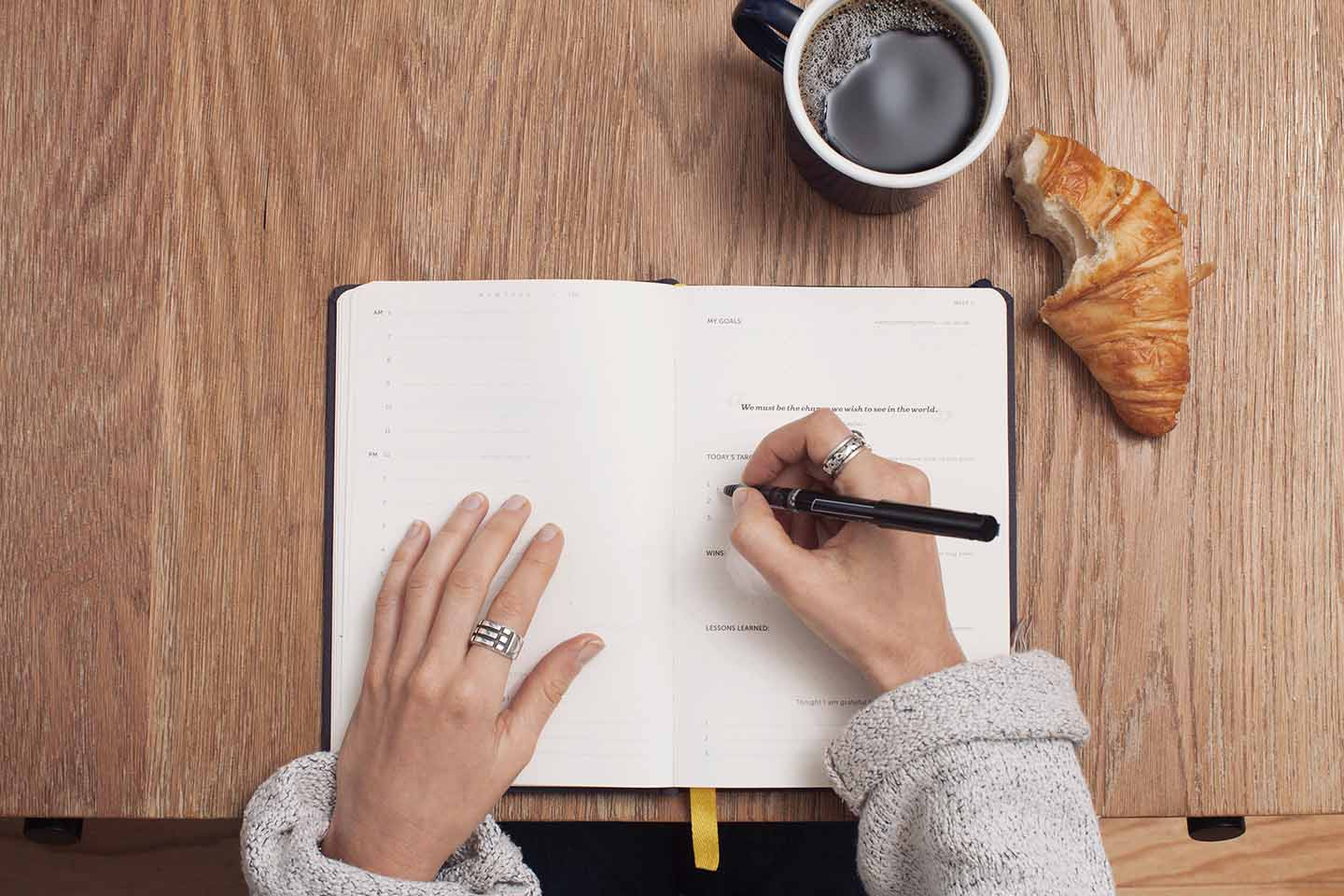 Image of person writing in a notebook