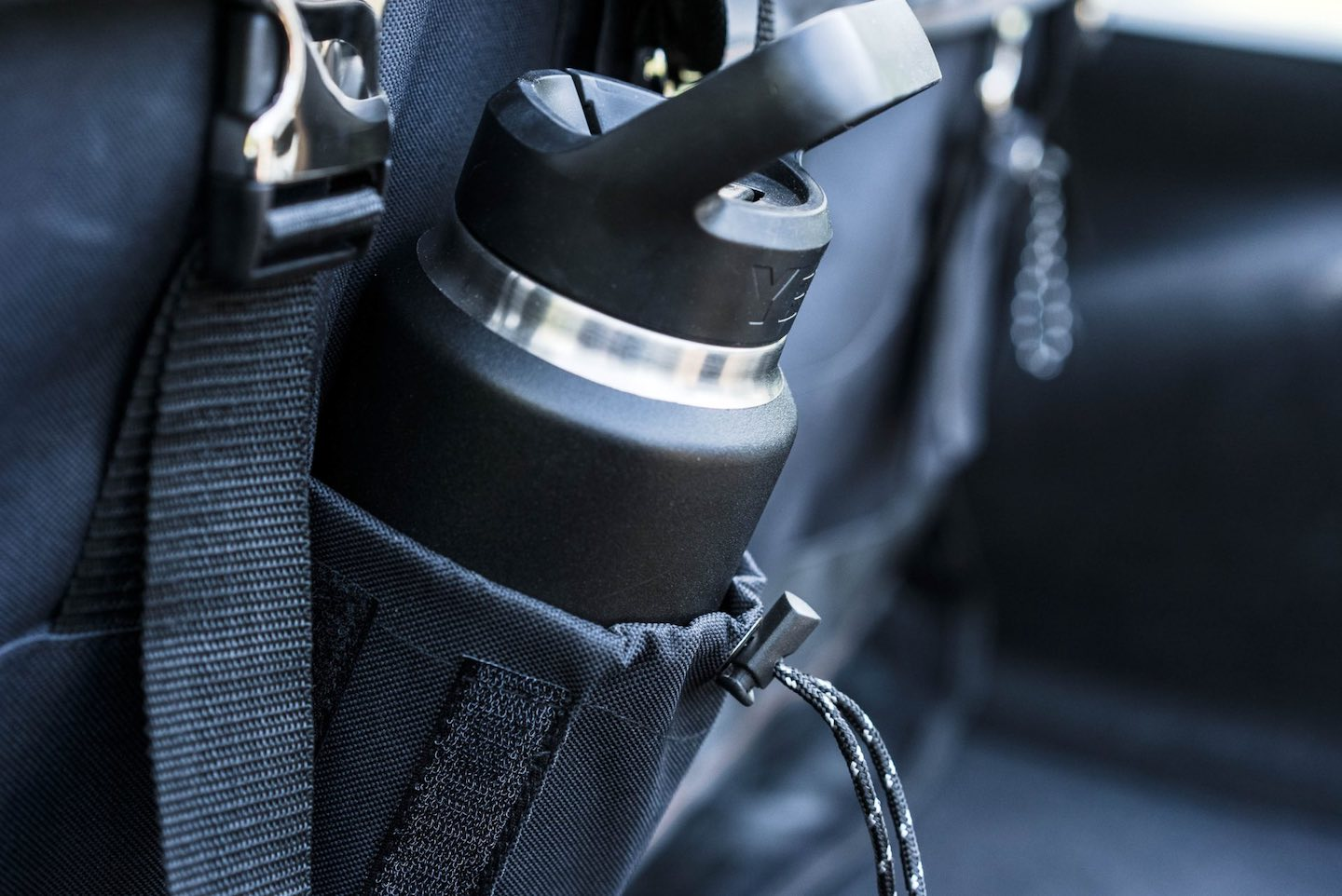 Image of a reuseable water bottle in a pocket