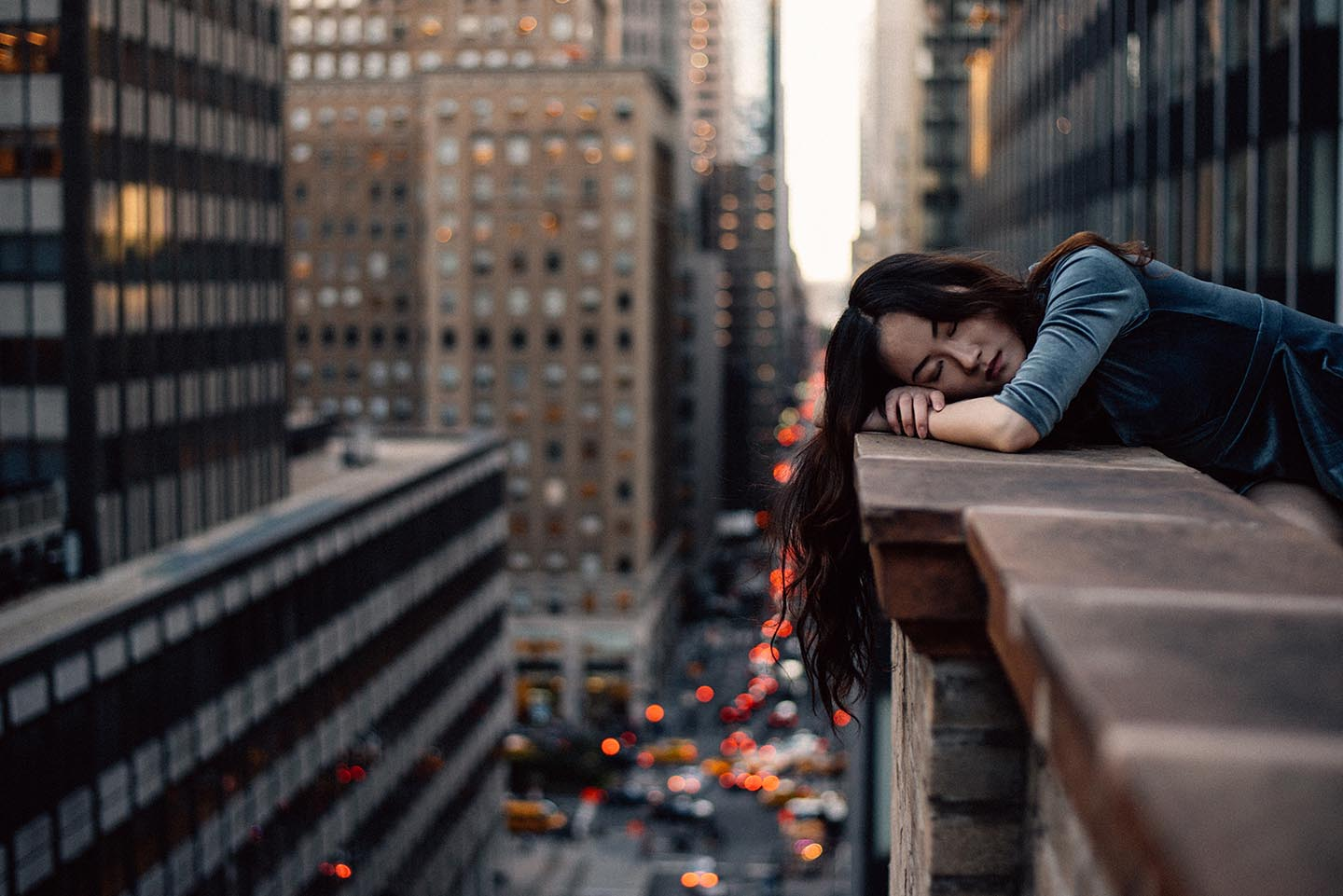 Image of girl resting on a city balcony