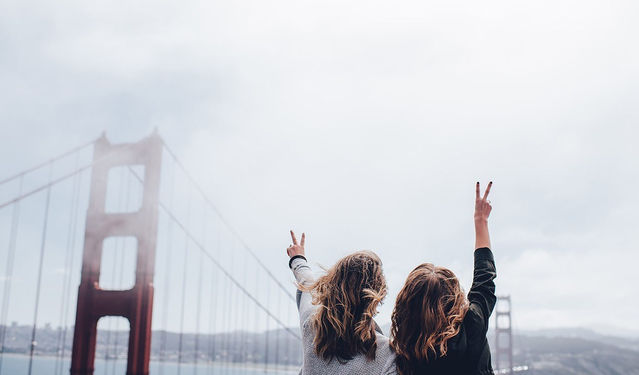 Image of girls making peace sign at the Golden Gate Bridge