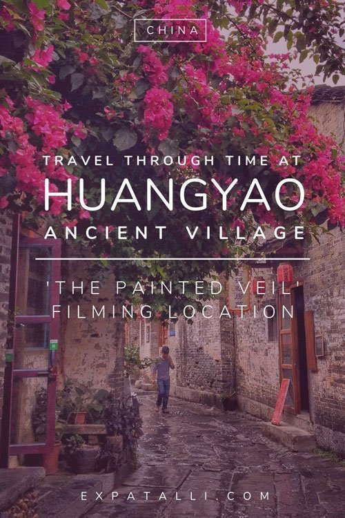 Pinterest image of a street in Huangyao with text: Travel through time at Huangyao Ancient Village