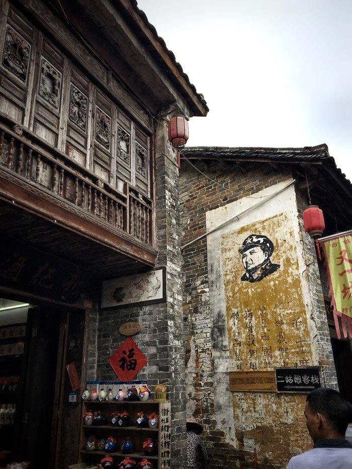 Posters on the side of a building in Huangyao Village | Image © ExpatAlli.com