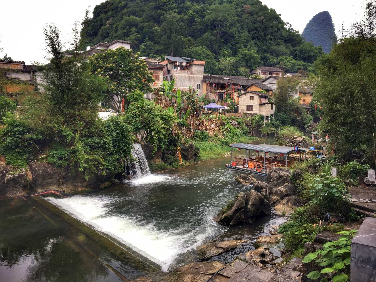 Lake with waterfall in Huangyao Village, China | Image © ExpatAlli.com
