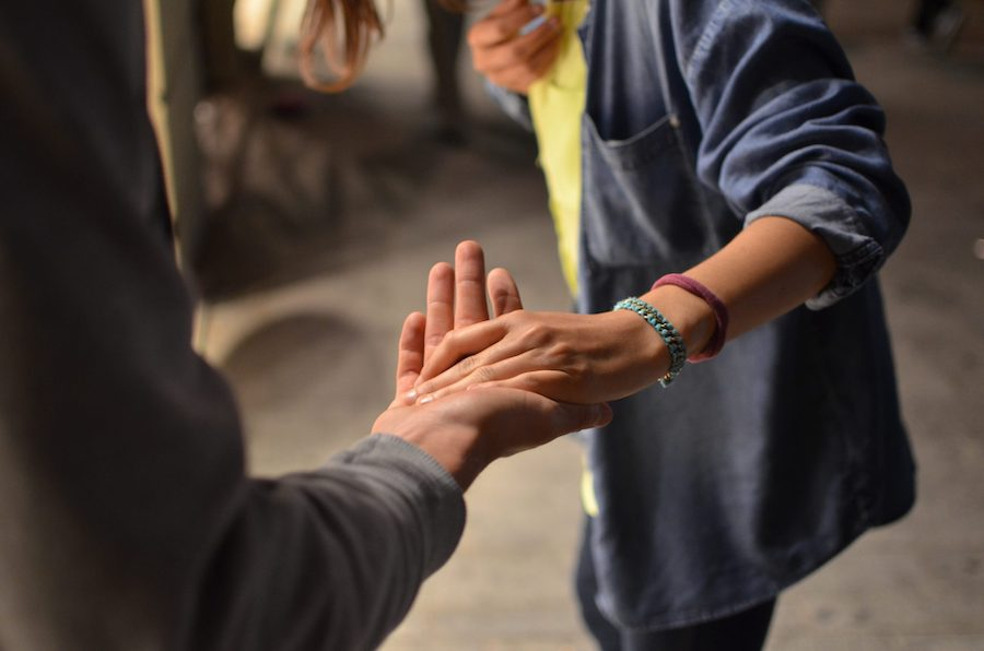 Image of a person extending their hand to someone else