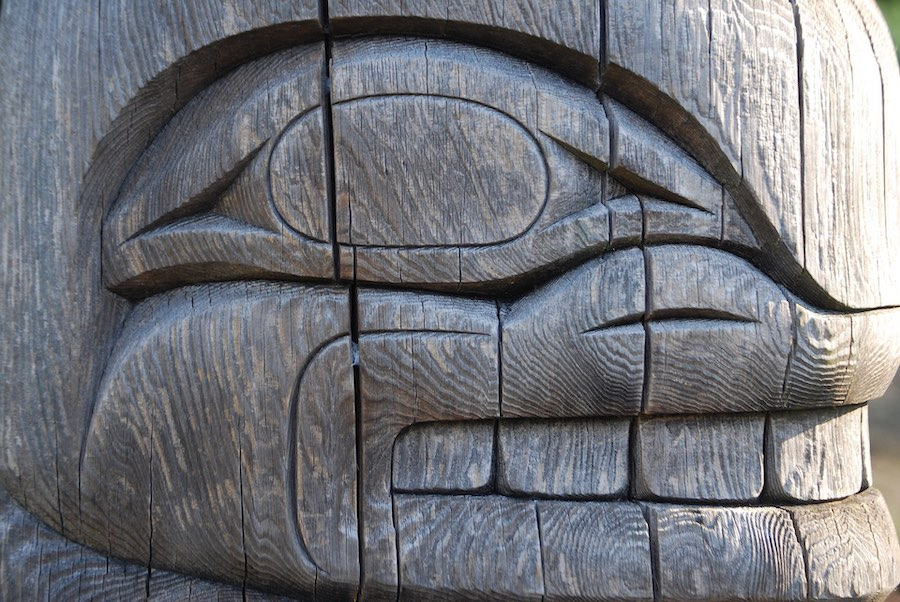 Closeup of a carved wooden totem near Vancouver, Canada | Image © ExpatAlli.com