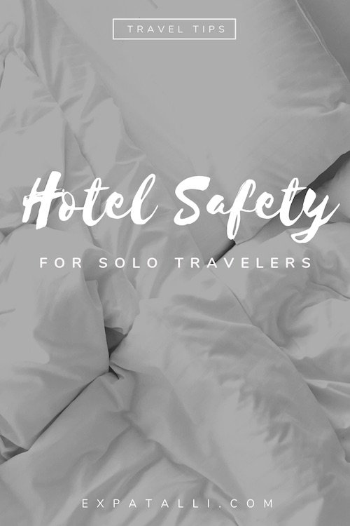 "Pinterest image of a hotel bed, with text: ""Hotel safety for solo travellers"""
