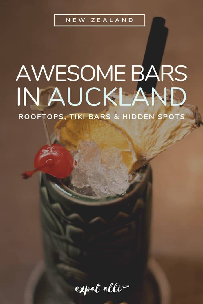 "Pinterest image of a tiki drink with text: ""Awesome bars in Auckland"""