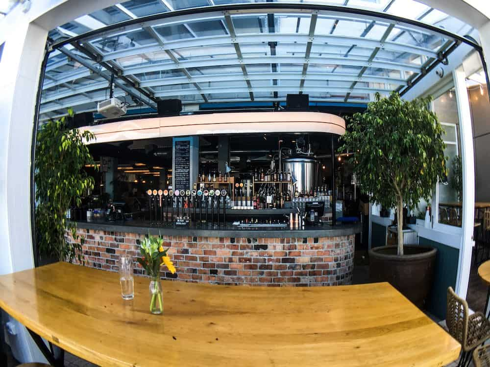 Fish eye view of the bar at Dr Rudi's, a great spot to grab a drink in Auckland | Image © ExpatAlli.com