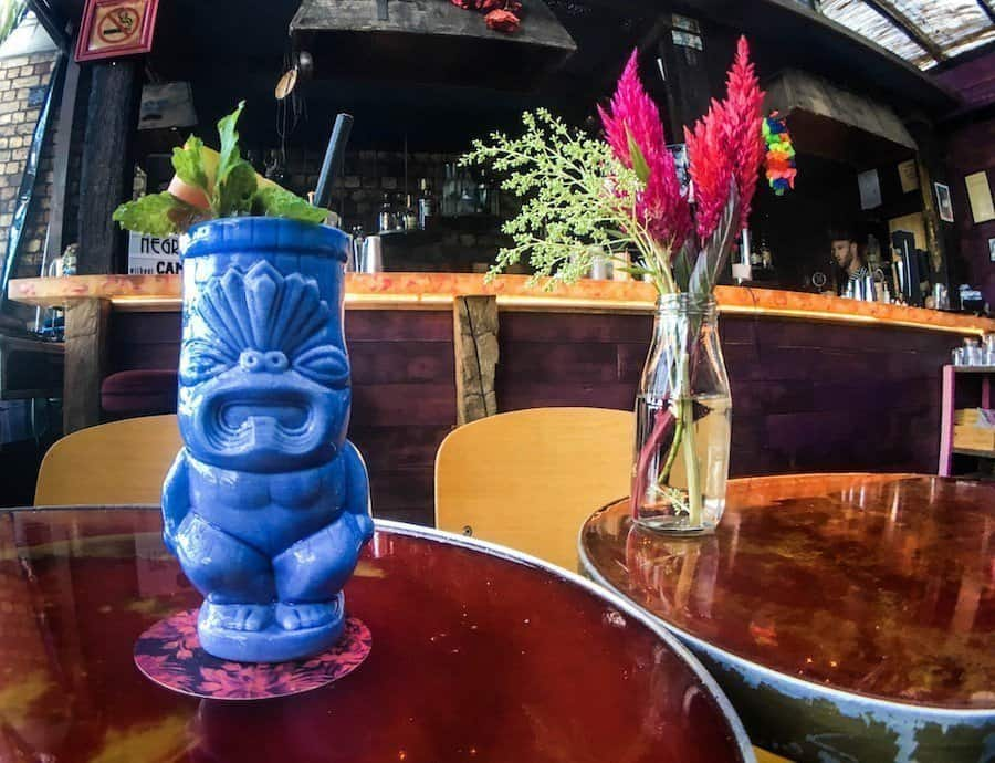 A tiki mug and flower arrangement in Talulah, a bar in Auckland's CBD | Image © ExpatAlli.com