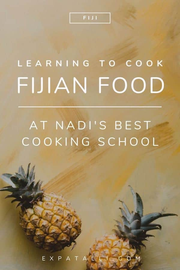 """Pinterest image of pineapples on a table with text: """"learning to cook Fijian food at Nadi's best cooking school"""""""