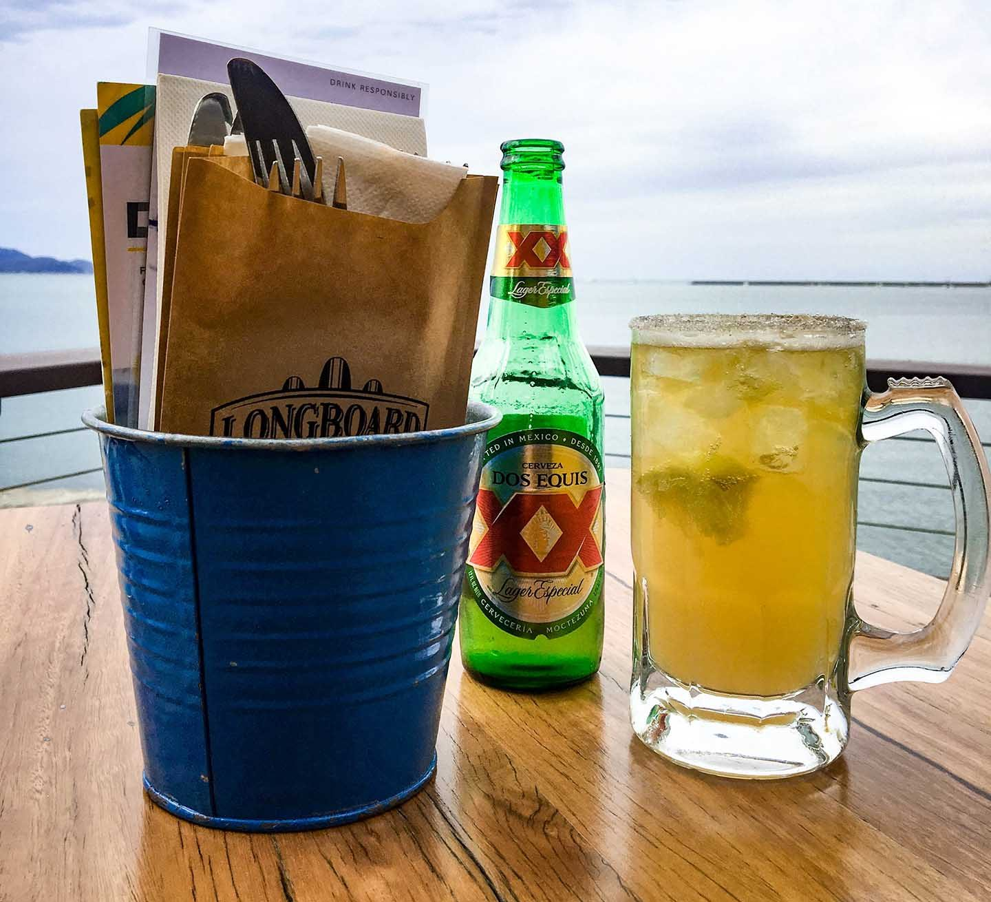 Image of beer on the deck of Longboard Bar & Grill | Image © ExpatAlli.com