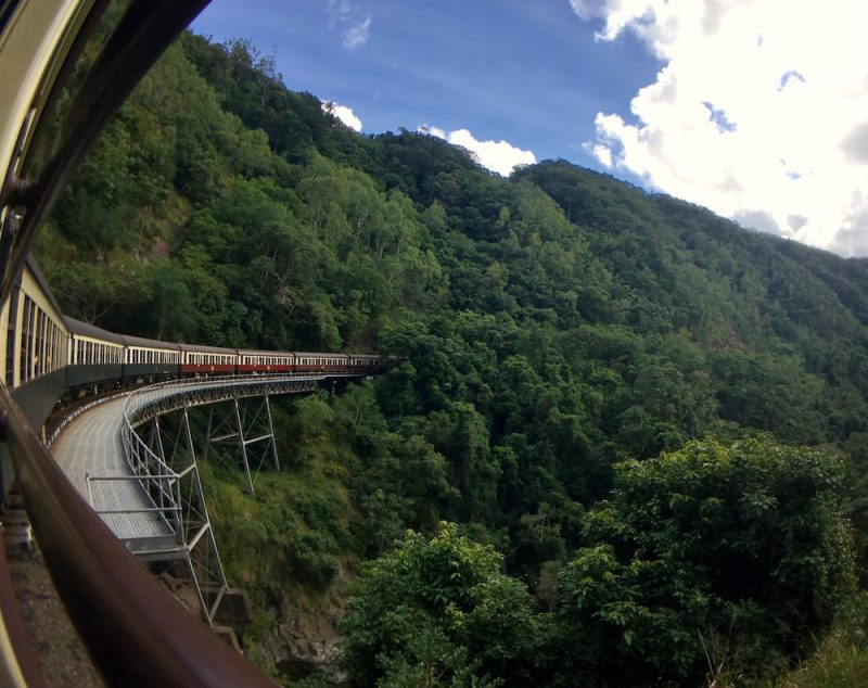 Image of the Kuranda Scenic Railway train going over a bridge | Image © ExpatAlli.com