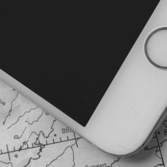 Image of iphone on top of map   Image © ExpatAlli.com