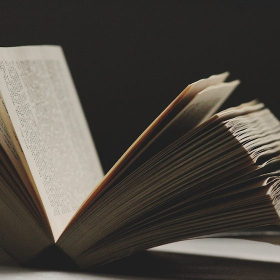 Image of open book on a table