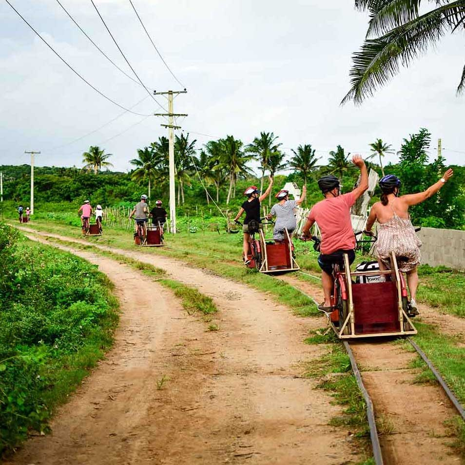 Ecotrax tour group waving to the villagers